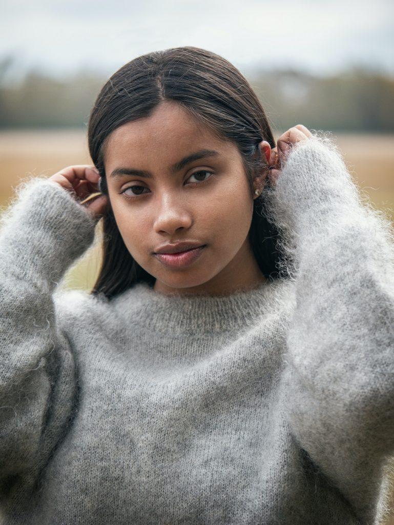 Beautiful Student Girl in grey sweater